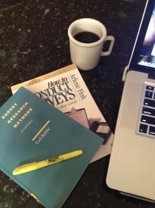 Survey books, coffee & computer
