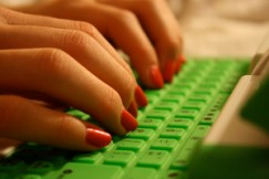 hands typing on keyboard by klepas via Flickr